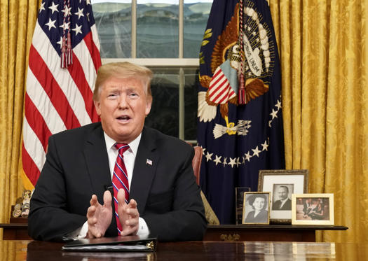 Slide 2 of 32: U.S. President Donald Trump delivers a televised address to the nation from his desk in the Oval Office about immigration and the southern U.S. border on the 18th day of a partial government shutdown at the White House in Washington, U.S., January 8, 2019. REUTERS/Carlos Barria     TPX IMAGES OF THE DAY