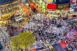 Japan has started charging a $9 (£7) departure tax on each person leaving the country. Pictured is the busy Shibuya Crossing in Tokyo, which is extremely popular with tourists