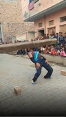 Iron-jawed Indian man throws 60kg log over his head using only his teeth