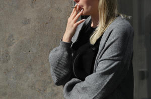 BERLIN, GERMANY - MAY 04:  A young woman smokes a cigarette during a break outside an office building on May 4, 2018 in Berlin, Germany. Smoking is banned in Germany in restaurants and most indoor venues.  (Photo by Sean Gallup/Getty Images)