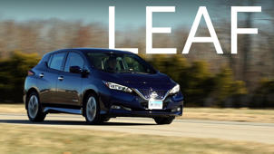 a car parked on the side of a road: 2018 Nissan Leaf Quick Drive