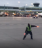 Airport worker puts on show for passengers