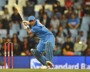 India's MS Dhoni bats during the second T20I cricket match between South Africa and India at Super Sport Park Stadium in Pretoria on February 21, 2018. / AFP PHOTO / Christiaan Kotze        (Photo credit should read CHRISTIAAN KOTZE/AFP/Getty Images)