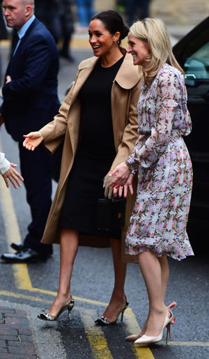 Kate Stephens (right) CEO of Smart Works welcomes the Duchess of Sussex (centre) as she arrives for a visit to Smart Works, in London, on the day that she has become their patron, as well as patron of the National Theatre, the Association of Commonwealth Universities, and the animal welfare charity, Mayhew.