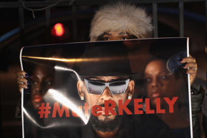 CHICAGO, ILLINOIS - JANUARY 09: Demonstrators gather near the studio of singer R. Kelly to call for a boycott of his music after allegations of sexual abuse against young girls were raised on the highly-rated Lifetime mini-series 'Surviving R. Kelly' on January 09, 2019 in Chicago, Illinois. Prosecutors in Illinois and Georgia have opened investigations into allegations made against the singer, whose real name is Robert Sylvester Kelly.   (Photo by Scott Olson/Getty Images)