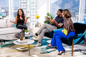 DAILY POP -- Episode 181203 -- Pictured: (l-r) Riverdale's Robin Givens chats on set with Daily Pop Co-Hosts Justin Sylvester and Carissa Culiner -- (Photo by: Aaron Poole/E! Entertainment/NBCU Photo Bank via Getty Images)