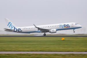 Flybe Embraer ERJ-195LR (ERJ-190-200 LR) with registration G-FBEG is landing at Amsterdam Schiphol International Airport in the mist in The Netherlands. Flybe connects Amsterdam to Birmingham, Doncaster Sheffield, East Midlands, Exeter, London City, Manchester and Southampton. The airline has a fleet of 78 aircraft. Flybe is suffering of financial difficulties and there are talks with Virgin to buy - rescue the airline. (Photo by Nicolas Economou/NurPhoto via Getty Images)