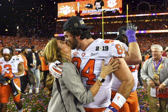 Slide 2 of 74: College Football: CFP National Championship: Clemson Cannon Smith (84) victorious, kissing his girlfriend Ashley on field after winning game vs Alabama at Levi's Stadium. Santa Clara, CA 1/7/2019 CREDIT: John W. McDonough (Photo by John W. McDonough /Sports Illustrated/Getty Images) (Set Number: X162407 TK1 )