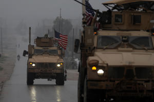 A picture taken on December 30, 2018, shows a line of US military vehicles in Syria's northern city of Manbij. - President Donald Trump announced last week that US troops would depart from Syria, leaving Manbij residents dreading a long-threatened attack by Turkey. (Photo by Delil SOULEIMAN / AFP)        (Photo credit should read DELIL SOULEIMAN/AFP/Getty Images)