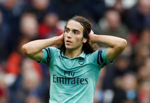 Guendouzi reacts after his attempt narrowly misses