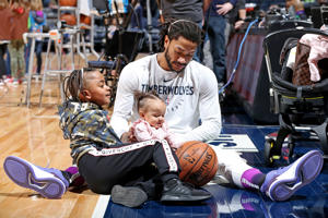 Derrick Rose #25 of the Minnesota Timberwolves hangs with his children prior to the game against the Dallas Mavericks on January 11, 2019 at Target Center in Minneapolis, Minnesota. NOTE TO USER: User expressly acknowledges and agrees that, by downloading and or using this Photograph, user is consenting to the terms and conditions of the Getty Images License Agreement. Mandatory Copyright Notice: Copyright 2019 NBAE (Photo by David Sherman/NBAE via Getty Images)