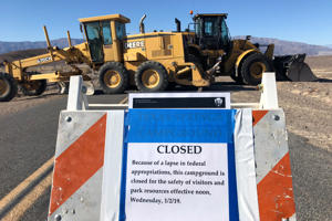 Construction vehicles block the entrance to Harmony Borax Works which is closed during the partial U.S. government shutdown in Death Valley, California