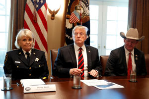 "President Donald Trump, with Carolyn ""Bunny"" Welsh, sheriff of Chester County, Pa., left, and AJ Louderback, sheriff of Jackson County, Texas, attends a roundtable discussion on border security with local leaders in the Cabinet Room of the White House"
