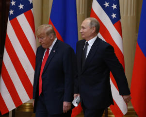 FILE: U.S. President Donald Trump (L) and Russian President Vladimir Putin arrive for a joint press conference after their summit on July 16, 2018 in Helsinki, Finland. The two leaders met one-on-one and discussed a range of issues including Russian meddling in the 2016 U.S election. (Photo by Mikhail Svetlov/Getty Images)