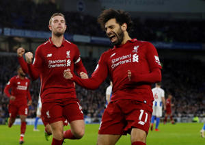 "Soccer Football - Premier League - Brighton & Hove Albion v Liverpool - The American Express Community Stadium, Brighton, Britain - January 12, 2019  Liverpool's Mohamed Salah celebrates scoring their first goal with Jordan Henderson   Action Images via Reuters/Paul Childs  EDITORIAL USE ONLY. No use with unauthorized audio, video, data, fixture lists, club/league logos or ""live"" services. Online in-match use limited to 75 images, no video emulation. No use in betting, games or single club/league/player publications.  Please contact your account representative for further details.     TPX IMAGES OF THE DAY"