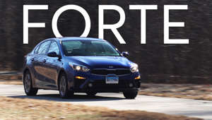 a car parked on the side of a road: 2019 Kia Forte Quick Drive