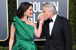 TOPSHOT - Actress Catherine Zeta-Jones (L) and Best Performance by an Actor in a Television Series  Musical or Comedy for 'The Kominsky Method' nominee Michael Douglas arrive for the 76th annual Golden Globe Awards on January 6, 2019, at the Beverly Hilton hotel in Beverly Hills, California. (Photo by VALERIE MACON / AFP)        (Photo credit should read VALERIE MACON/AFP/Getty Images)