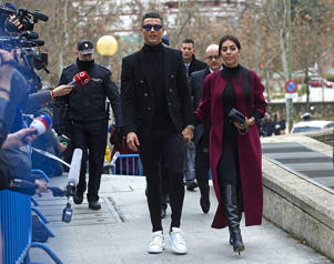 Cristiano Ronaldo arrives with his girlfriend Georgina Rodriguez to attend a court hearing for tax evasion at Audiencia Provincial on January 22, 2019 in Madrid, Spain. (Photo by fotopress/GC Images)