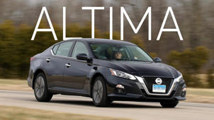 a car parked in front of a building: 2019 Nissan Altima Road Test