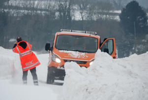 BATH, UNITED KINGDOM - MARCH 02:  A RAC patrol man stops to take a photograph of his van as vehicles attempt to drive through drifting snow that has formed on the A46, the main motorway link road for Bath to the M4, on March 2, 2018 near Bath, England. Weather fronts dubbed Storm Emma and The Beast From The East have combined to create freezing conditions that have bought much of the UK to a standstill. Businesses have closed, some towns are inaccessible and flights have been cancelled costing the British economy millions of pounds.  (Photo by Matt Cardy/Getty Images)
