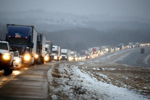 Motorists wait for Interstate 70 to open after it was closed near Manhattan, Kan., due to icy conditions as a winter storm moved through the area Tuesday, Jan. 22, 2019.