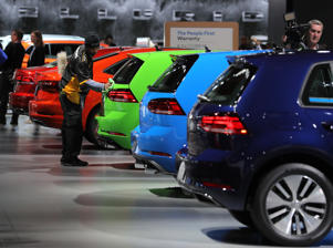 A worker dusts Volkswagen Golf models displayed during the second media preview day at the North American International Auto Show in Detroit, Michigan, U.S., January 15, 2019. REUTERS/Brendan McDermid