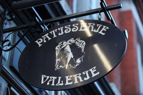 A sign is pictured above the entrance to a Patisserie Valerie cafe in London on January 23, 2019. - British cafe chain Patisserie Valerie announced on Tuesday that it had fallen into administration, threatening the jobs of almost 3,000 staff at its nearly 200 locations. 'Patisserie Holdings plc announces today that...it has been unable to renew its bank facilities, and therefore regrettably the business does not have sufficient funding to meet its liabilities as they fall due,' it said in a statement to the London Stock Exchange. (Photo by Daniel LEAL-OLIVAS / AFP)        (Photo credit should read DANIEL LEAL-OLIVAS/AFP/Getty Images)