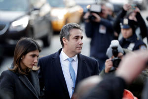 FILE: Michael Cohen, right, President Donald Trump's former lawyer, arrives at federal court with his daughter, Samantha Cohen, for his sentencing for dodging taxes, lying to Congress and violating campaign finance laws in New York on Wednesday, Dec. 12, 2018. (AP Photo/Julio Cortez)