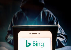HONG KONG, CHINA - 2018/11/27: Web search engine owned by Microsoft, Bing, logo is seen on an Android mobile device with a figure of hacker in the background. (Photo by Miguel Candela / SOPA Images/SOPA Images/LightRocket via Getty Images