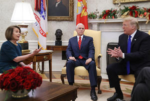 FILE: WASHINGTON, DC - DECEMBER 11:  U.S. President Donald Trump (R) argues about border security with House Minority Leader Nancy Pelosi (D-CA) as Vice President Mike Pence (C) sits nearby in the Oval Office on December 11, 2018 in Washington, DC.  (Photo by Mark Wilson/Getty Images)