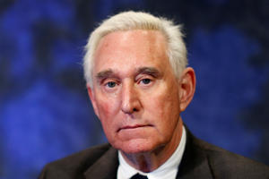 Roger Stone wearing a suit and tie: Trump's longtime political ally Roger Stone was arrested on charges of obstruction, witness tampering and making false statements related to the release of stolen Democratic Party emails during the 2016 presidential campaign. REUTERS/Brendan McDermid