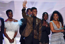 (L-R) Danai Gurira, Chadwick Boseman, Lupita Nyong'o, Angela Bassett and the cast of 'Black Panther' accept the award for best Cast In A Motion Picture, during the 25th Annual Screen Actors Guild Awards show at the Shrine Auditorium in Los Angeles on January 27, 2019. (Photo by Frederic J. BROWN / AFP)        (Photo credit should read FREDERIC J. BROWN/AFP/Getty Images)