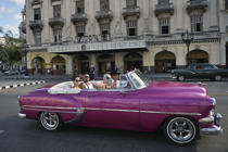Tourists ride on an old American car used as taxi in Havana, on Jan. 15, 2019.