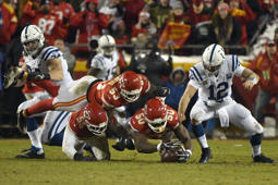Kansas City Chiefs linebacker Justin Houston (50), joined by linebackers Dee Ford (55) andAnthony Hitchens (53), leaps to recover a ball fumbled by Indianapolis Colts quarterback Andrew Luck (12) during the second half of an NFL divisional football playoff game in Kansas City, Mo., Saturday, Jan. 12, 2019. (AP Photo/Ed Zurga)
