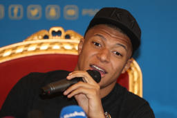 Paris Saint-Germain's French forward Kylian Mbappe holds a press conference on January 14, 2019 in Doha as the team start their winter training camp in the Qatari capital. (Photo by KARIM JAAFAR / AFP)        (Photo credit should read KARIM JAAFAR/AFP/Getty Images)