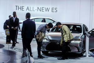 LOS ANGELES, Nov. 30, 2018 -- Attendees look at the 2019 Lexus ES during the media preview at the 2018 Los Angeles Auto show in Los Angeles, the United States, Nov. 28, 2018. The LA Auto Show opens to the public on Nov. 30 and runs through Dec. 9. (Xinhua/Zhao Hanrong) (Xinhua/Zhao Hanrong via Getty Images)
