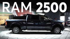 a car parked in front of a truck: 2019 Detroit Auto Show: 2019 Ram 2500