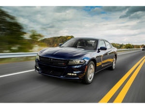 a car driving on a road: 2019 Dodge Charger