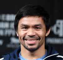 AS VEGAS, NEVADA - JANUARY 16: WBA welterweight champion Manny Pacquiao smiles during a news conference at MGM Grand Hotel & Casino on January 16, 2019 in Las Vegas, Nevada. Pacquiao will defend his title against Adrien Broner on January 19 at MGM Grand Garden Arena in Las Vegas.