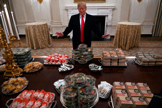 Slide 1 of 31: President Donald Trump talks to the media about the table full of fast food in the State Dining Room of the White House in Washington, Monday, Jan. 14, 2019, for the reception for the Clemson Tigers. (AP Photo/Susan Walsh)