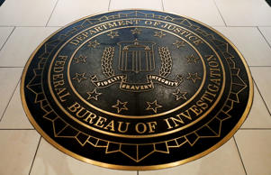 The Federal Bureau of Investigation seal is seen at FBI headquarters in Washington, June 14, 2018.