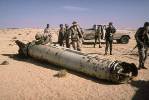 Military personnel examine a Scud missile shot down in the desert by an MIM-104 Patriot tactical air defense missile during Operation Desert Storm.