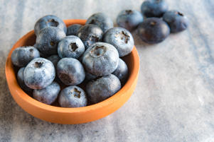 TORONTO, ONTARIO, CANADA - 2017/01/16: Blueberries fruit is a small clay recipient. They are over a marble surface. Health benefits of the blueberry include being rich in antioxidants. (Photo by Roberto Machado Noa/LightRocket via Getty Images)