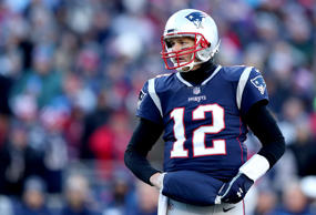 CAPTION: FOXBOROUGH, MASSACHUSETTS - JANUARY 13: Tom Brady #12 of the New England Patriots looks on during the second quarter in the AFC Divisional Playoff Game against the Los Angeles Chargers at Gillette Stadium on January 13, 2019 in Foxborough, Massachusetts.`