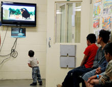 "A detained immigrant child watches a cartoon while awaiting the arrival of U.S. first lady Melania Trump with other young detained immigrants at a U.S Customs and Border patrol immigration detainee processing facility in Tucson, Arizona, U.S. June 28, 2018. Reuters photographer Leah Millis: ""This photograph was taken while was following first lady Melania Trump as she toured detention facilities run by U.S. Customs and Border Patrol, like this one. There were minors in this facility, but the very young children we saw (like the one pictured here) were with their mothers."" REUTERS/Leah Millis  SEARCH ""IMMIGRATION POY"" FOR THIS STORY. SEARCH ""REUTERS POY"" FOR ALL BEST OF 2018 PACKAGES. TPX IMAGES OF THE DAY."