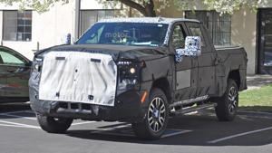 a car parked on the side of a road: 2020 GMC Sierra Denali 2500 HD