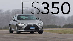 a car parked on the side of a road: 2019 Lexus ES Quick Drive