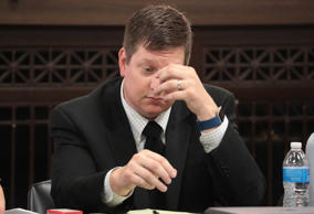 Chicago police officer Jason Van Dyke listens during the trial