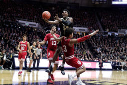 Purdue forward Trevion Williams (50) is fouled by Indiana forward Justin Smith (3) as he shoots during the second half of an NCAA college basketball game in West Lafayette, Ind., Saturday, Jan. 19, 2019. Purdue defeated Indiana 70-55. (AP Photo/Michael Conroy)