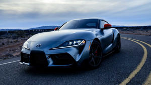 a car parked in a parking lot: First Production 2020 Toyota Supra Sold At Auction